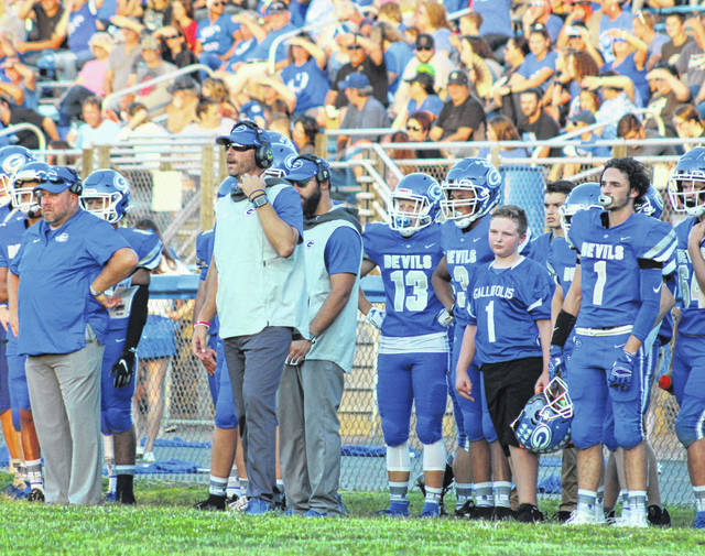 Gallia Academy head football coach Alex Penrod looks on from the sidelines during a Week 3 contest against Point Pleasant at Memorial Field in Gallipolis, Ohio. The Blue Devils are 23-8 under Penrod in three seasons and are aiming for the program's first playoff victory since 2012 on Saturday night at Waverly High School.