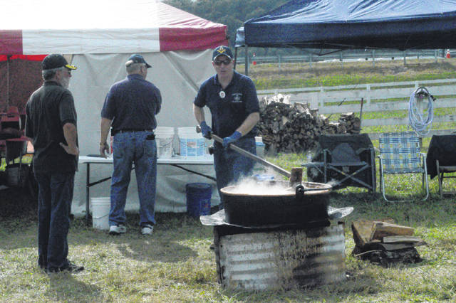 The Bob Evans Farm Festival commonly sees all manner of cooking and food types stirring. Here, area Masons make apple butter.