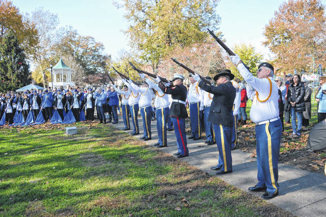 Veterans at the end of the Gallia Veterans Day Ceremony and parade hold a firing salute. For more photos of the days events, turn to page three of today's issue.