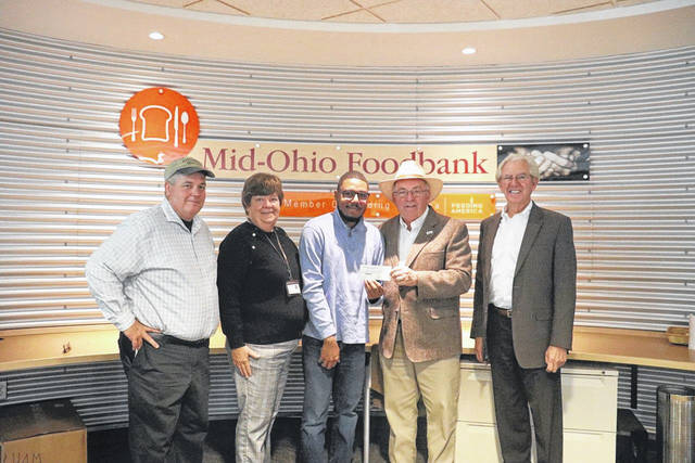 Steve Evans Sausage donates to the Mid-Ohio Foodbank. From left to right are Michael Pierre, sales director for Steve Evans Sausage, Laurie Coleman, Mid-Ohio Foodbank, Steve Evans, Ike Stage, mayor of Grove. Donations were made in honor of Jewell Evans, Steve's mother, who would have been 100, Nov. 4