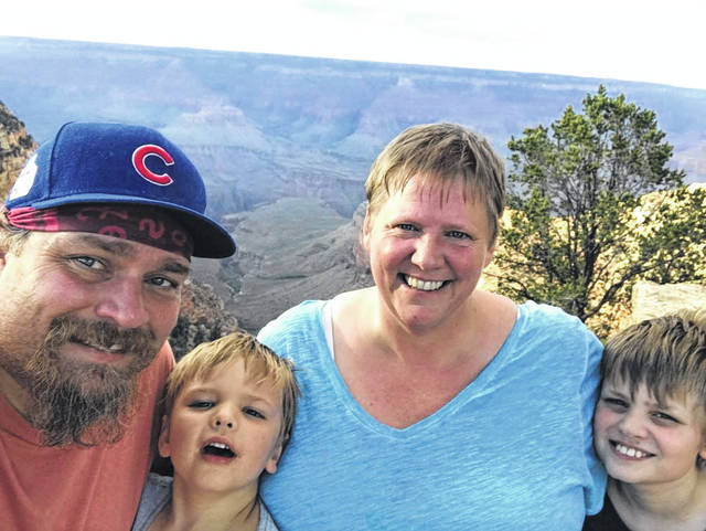 Karen Craigo, Gallipolis native and Missouri's new Poet Laureate, is pictured during a vacation at the Grand Canyon with her husband and sons, from left Michael, Keats and Ernie Czyzniejewski.
