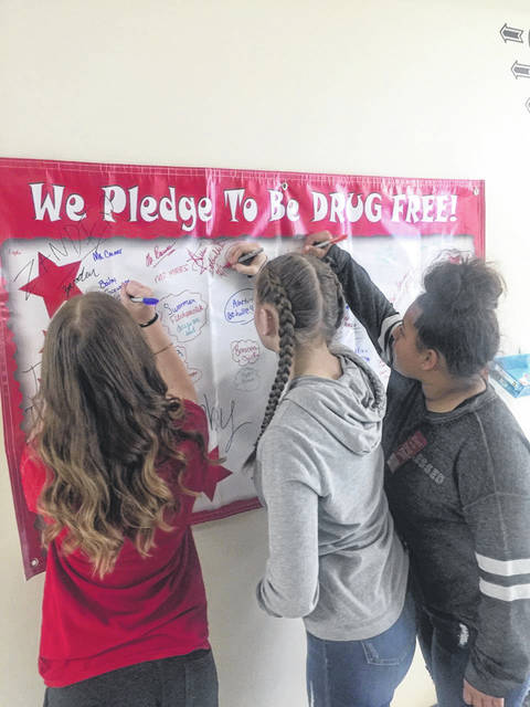 Students at Gallia Academy Middle School sign a pledge to remain drug free.