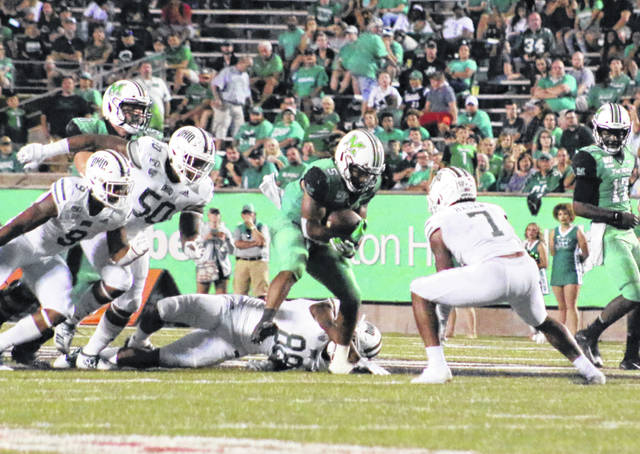 Marshall running back Sheldon Evans (5) prepares to run into Ohio safety Javon Hagan (7) during a Sept. 14 football game at Joan C. Edwards Stadium in Huntington, W.Va.