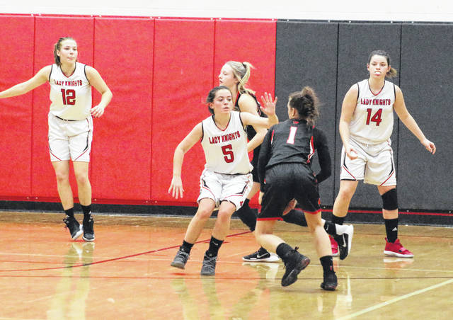 Point Pleasant senior Morgan Miller (5) pressures a Wayne guard as teammates Tristan Wilson (12) and Baylie Rickard provide help during the second half of Monday night's girls basketball contest in Point Pleasant, W.Va.