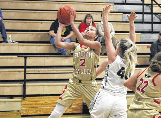 South Gallia's Amaya Howell (2) tries a two-pointer over Eastern's Whitney Durst (40), during Monday's TVC Hocking bout in Tuppers Plains, Ohio.