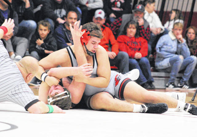 Point Pleasant senior Juan Marquez tries to pin his Winfield opponent to the mat during Wednesday night's Class AA Region IV Team Duals Championship held in Point Pleasant, W.Va.