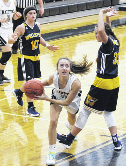 River Valley senior Savannah Reese (center) goes up for a layup between Lady Rockets Makenna Kilgour (10) and Emma Jadrnicek (33), during the Lady Raiders' 64-33 victory on Thursday in Bidwell, Ohio.