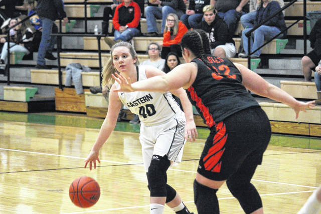 EHS junior Whitney Durst (40) drives past BHS junior Curstin Giffin (32), during the second half of Belpre's 40-35 victory on Monday in Tuppers Plains, Ohio.