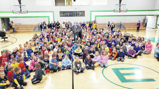 Eastern Elementary students and staff are pictured with Principal Robin Burrow as they celebrated her son's Heisman win.