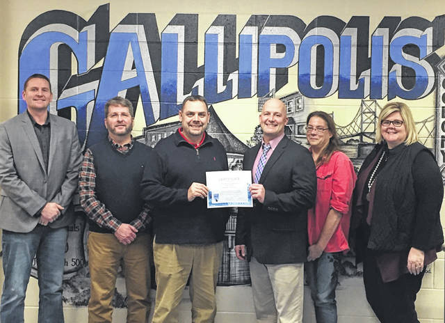 Pictured are the men and women serving the Gallipolis City School District including Lynn Angell, Troy Miller, John O'Brien, Amee Rees, and Morgan Saunders. Also pictured is Superintendent Craig Wright noting the contributions of school board members.
