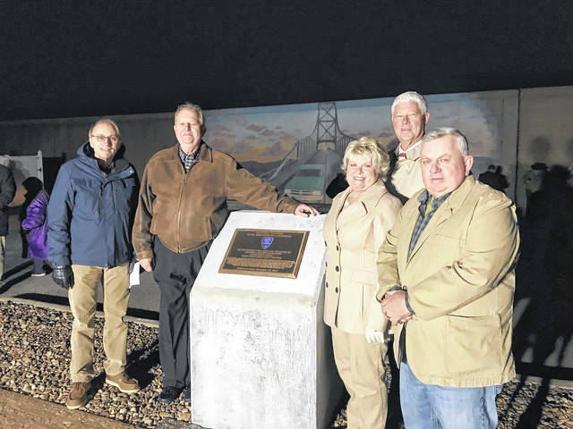 Pictured from left, Gallia County Commissioners David Smith and Harold Montgomery and Mason County Commissioners Tracy Doolittle, Rick Handley and Sam Nibert. The officials attended a ceremony designating the Silver Bridge as a National Historic Civil Engineering Landmark.