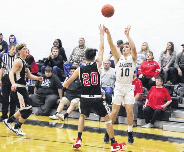 River Valley senior Cole Young (10) releases a shot attempt during the second half of Friday night's boys basketball contest against Point Pleasant in Bidwell, Ohio.