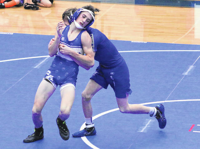Gallia Academy sophomore Todd Elliott breaks free from a Warren opponent during a 113-pound match held Dec. 18 at Gallia Academy High School in Centenary, Ohio.