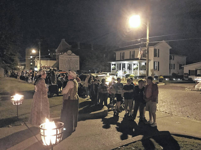 """The Point Pleasant Battle Days committee is hosting """"A Colonial Christmas"""" this Saturday at the Mansion House located at Tu-Endie-Wei State Park. Ticket-holders can travel back to 1796 to experience colonial customs and how people celebrated Christmas. Pictured is a previous candlelight tour of the park held during Battle Days."""