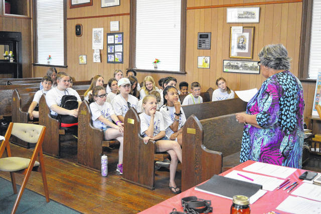 Washington Elementary students sit and listen to a lesson about local black history from the John Gee Black Historical Center's Bobette Braxton earlier in the year.
