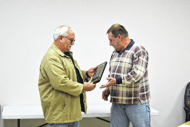 Previous Gallipolis City Manager Gene Greene receives recognition for years of service from Gallipolis City Commissioner Mike Fulks.