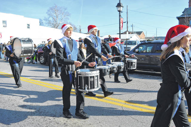 Gallia Academy Marching Band echoes drum beats in downtown Gallipolis.
