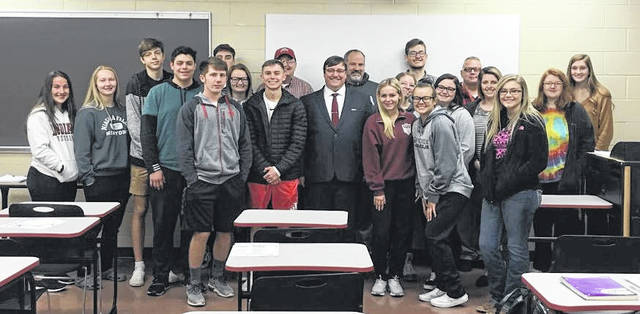 Dustin Brown, representative from the Social Security Administration in Gallipolis, served as a guest speaker at the University of Rio Grande Main Campus. Brown visited Kevin Compston's American National Government class on Nov. 20. Brown spoke to the students about the history of the Social Security Administration and how it impacts the daily life of all Americans. Front row left to right: Alison Roush, Bailey Wray, Carter Smith, Trenton Wolford, Dustin Brown, Trinity Hassey, Riley Biri, Madelyn Moore, Halee Burchett, Riley Stevens, Katilinn Fraley. Back row from left to right: Joe Crabtree, Haydn Brown, Stephen Smith, Chris Somerville, Tristin Janey, Mr. Compston, Mikenzi Pope.