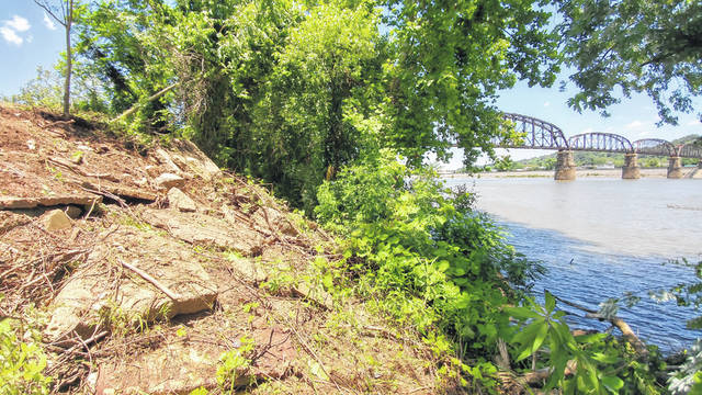 Remains of the Silver Bridge Collapse rested along the Ohio River bank as West Virginia Department of Transportation crews removed concrete debris and metal in June 2019.