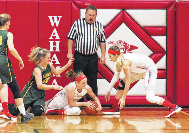 Wahama freshman Amber Wolfe dives on a loose ball during the first half of Thursday night's girls basketball contest against Eastern in Mason, W.Va.