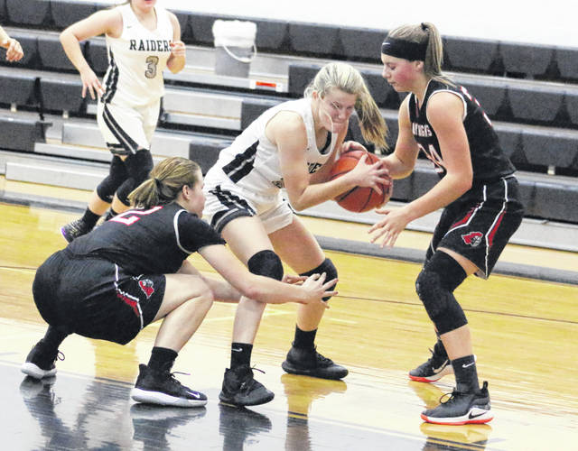 River Valley junior Sierra Somerville, middle, gains control of the ball while being swarmed by Point Pleasant defenders Tristan Wilson, left, and Tayah Fetty during the second half of Monday night's girls basketball game in Bidwell, Ohio.