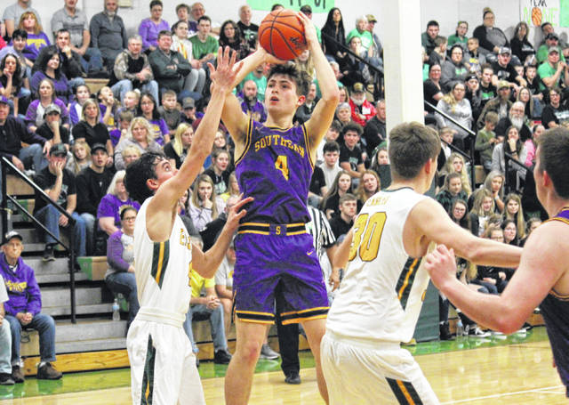 Southern senior Landen Hill (center) tries a two-pointer over Eagles Trevor Morrissey (left) and Garrett Barringer (30), during the Tornadoes' 49-44 victory on Tuesday in Tuppers Plains, Ohio.
