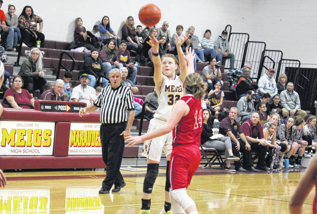 Meigs sophomore Mallory Hawley (32) fires a three-pointer over Wahama freshman Amber Wolfe (14), during the Lady Marauders' 50-31 victory on Wednesday in Rocksprings, Ohio.