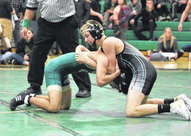 River Valley freshman Andrew Huck, right, locks in a hold during a 113-pound match Wednesday night at Athens High School in The Plains, Ohio.