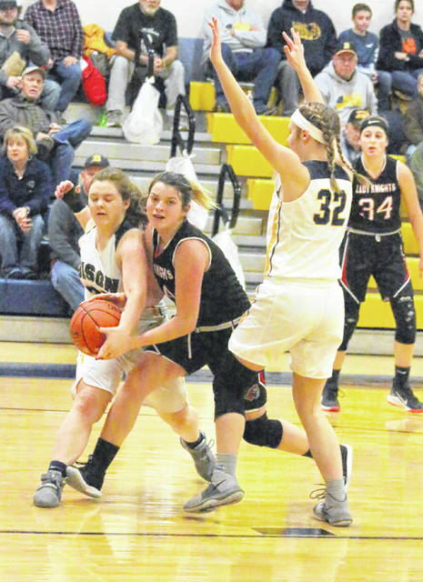 Point Pleasant sophomore Baylie Rickard, middle, has the ball stripped away by Buffalo defender Baylee Hudnall, left, during the first half of Thursday night's girls basketball contest in Buffalo, W.Va.