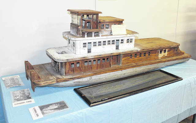 The wooden boat on display was built by Hobart Udell Adams who was a riverboat man for most of his life. He was born in 1907 in Antiquity and died in 1941 of cancer. The model is made from dynamite boxes.