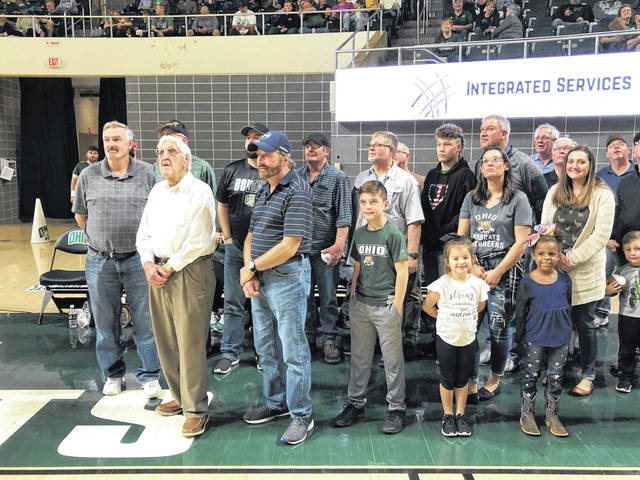 Surrounded by more than two dozen friends and family members, Ralph Sayre was honored for his sports accomplishments recently at Ohio University. A portion of the group is pictured with the New Haven resident while they watch photos of Sayre being shown on the big screen scoreboard. The tribute was arranged by the Wahama High School Hall of Fame.