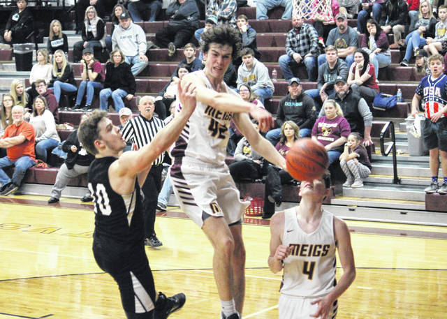 Meigs senior Bobby Musser (42) earns his third blocked shot of the game, during the Marauders' 61-48 victory over River Valley on Tuesday in Rocksprings, Ohio.