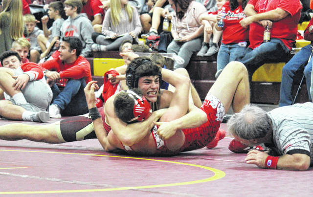 South Gallia junior Kenny Siders gets into pinning position against Wahama's Gavin Stiltner, during the Meigs Invitational on Saturday in Rocksprings, Ohio.