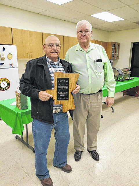Ronnie Slone, pictured at right, president of the Gallia County Fair Board, recently presented Paul Shoemaker, at left, a plaque for his 39 years of service as a director to the Gallia County Agricultural Society. Shoemaker was also recognized for the fair's 2019 Outstanding Fair Supporter Award. His name was submitted to the Ohio Department of Agriculture Department where he received a certificate for his outstanding service to the Gallia County Junior Fair.