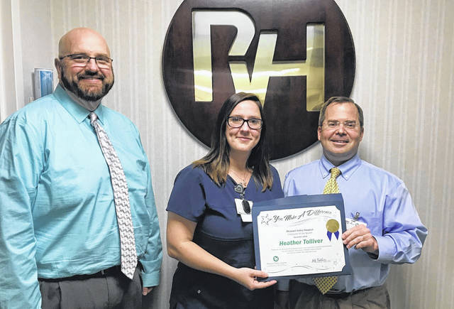 Pictured is Heather Tolliver, at center, along with Jeff Noblin, FACHE, PVH CEO, and Shawn Cole, PVNRC director of nursing.
