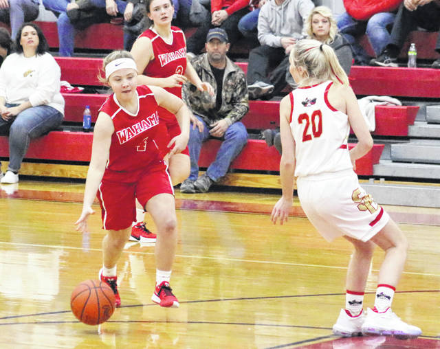 Wahama sophomore Bailee Bumgarner (4) dribbles around a South Gallia defender during a Dec. 19, 2019, girls basketball contest in Mercerville, Ohio.