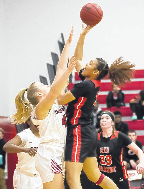 Rio Grande's Hailey Jordan puts up a shot over Indiana University-Kokomo's Kimberlee Kingma during the first half of Thursday night's game at the Newt Oliver Arena. The Cougars upended the RedStorm, 97-90.