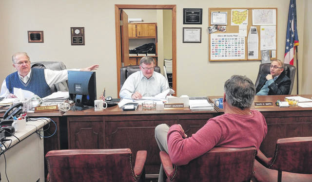Gallia Commissioners Harold Montgomery, Brent Saunders and David Smith meet with Gallia Auditor Larry Betz during the first commissioner meeting of the year.