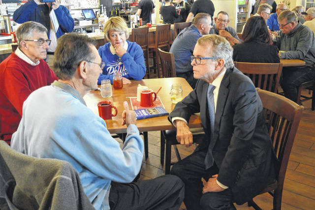 Governor Mike DeWine speaks with Gallia residents in 2018 while campaigning in Rio Grande at the Bob Evans Farm.