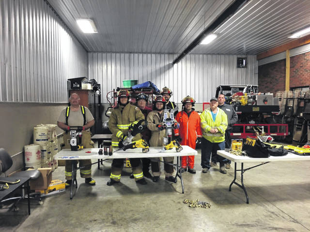 Rio Grande Firefighters stand with recently purchased safety and extraction equipment.