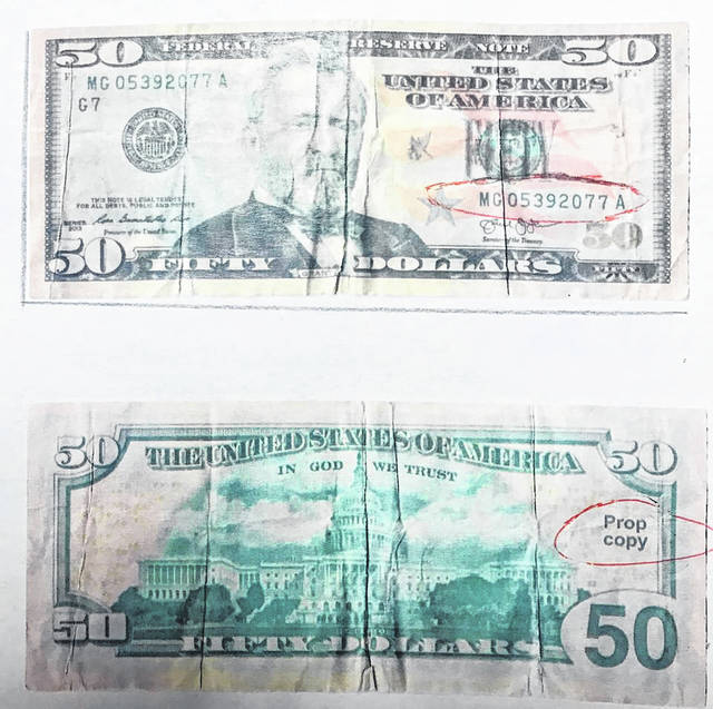 Pictured is a reported fake $50 bill recovered by the Mason Police Department as part of an ongoing investigation. The counterfeit currency is being distributed within the department's jurisdiction.