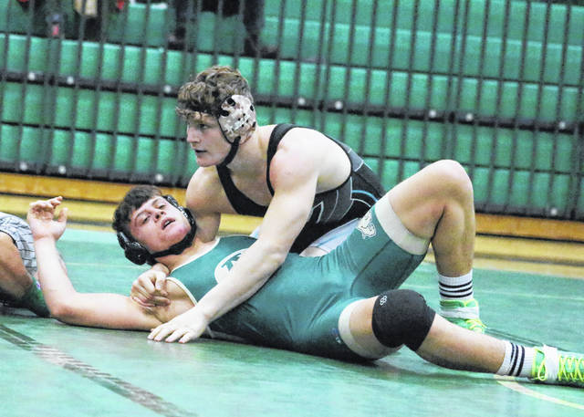River Valley sophomore Will Hash finishes off a pinfall victory against Athens during a 152-pound match on January 15 in The Plains, Ohio.