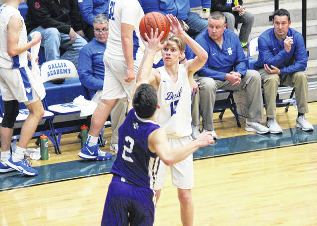 Gallia Academy senior Reece Thomas fires a three-pointer over Chesapeake's Travis Grimm (2) during the Panthers' 63-46 victory on Wednesday in Centenary, Ohio.