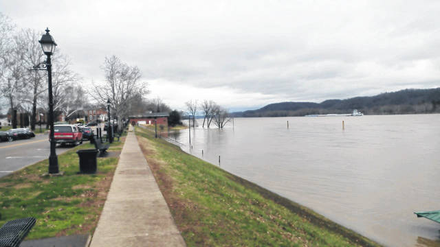 The Ohio River rises alongside City Park and First Avenue in Gallipolis on Thursday afternoon.