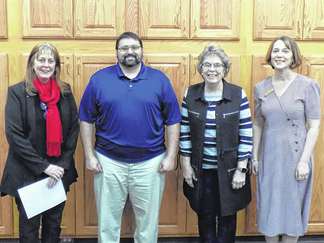Gallia County District Library Board of Trustees members Jacob Attar and Debbie Rhodes recently took their oaths of office at Bossard Memorial Library in Gallipolis. Pictured are, from left: Gallia County Common Pleas Judge Margaret Evans, Jacob Attar, Debbie Rhodes, and Debbie Saunders, library director.