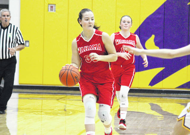 Wahama sophomore Lauren Noble brings the ball up the floor in front of freshman teammate Amber Wolfe, during the Lady Falcons' game at Southern on Jan. 18 in Racine, Ohio.