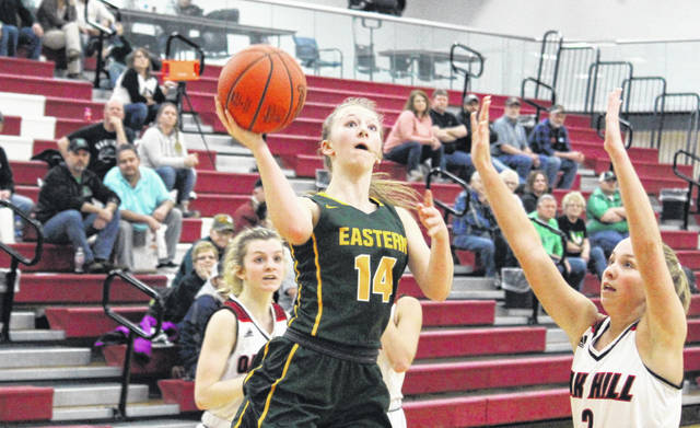 Eastern freshman Sydney Reynolds (14) shoots a layup in the second half of the Lady Eagles' 52-50 loss to Oak Hill, during the D-3 sectional semifinal on Thursday night in Jackson, Ohio.
