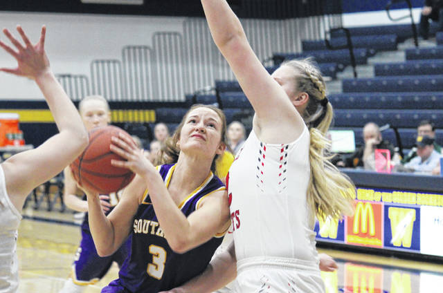 Southern senior Baylee Wolfe (3) goes up for a shot in the lane, during the Lady Tornadoes' 68-46 loss in the sectional final on Saturday in Wellston, Ohio.