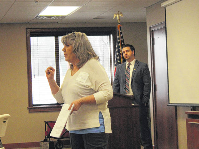 Meigs County Victim Assistance Director Theda Petrasko speaks during the Partners for Justice meeting on Friday morning as Prosecutor James K. Stanley looks on.