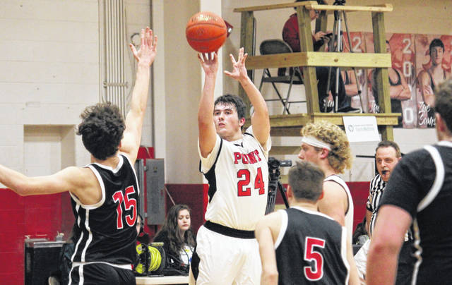 PPHS senior Braxton Yates (24) fires a long range shot, during the Big Blacks' 40-point win over Wayne on Feb. 18 in Point Pleasant, W.Va.